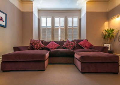 Penman Interiors Dulwich London TV Room Shutters Purple Sofa Lounging